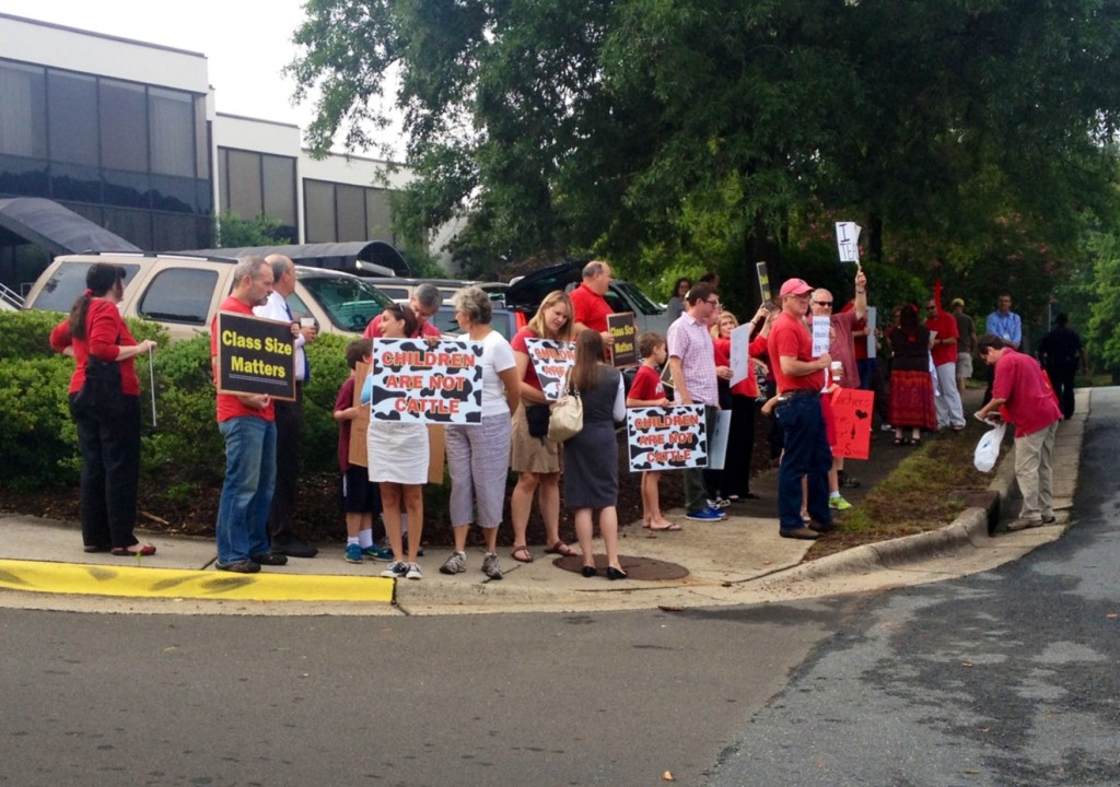 Protesters by McCrory's Thursday speech