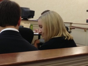 Wiley speaking with her attorney