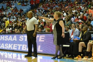 Coach Sherry Norris sends out instructions.