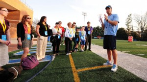 Coach Fedora chats with UNC faculty (UNC Athletics)