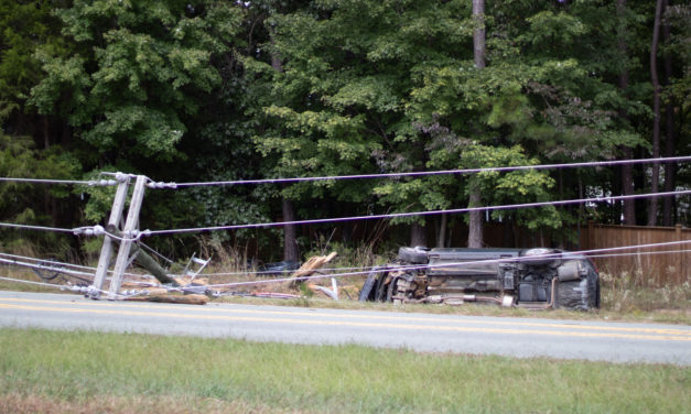 Vehicle Wreck on Homestead Road Downs Chapel Hill Utility Pole